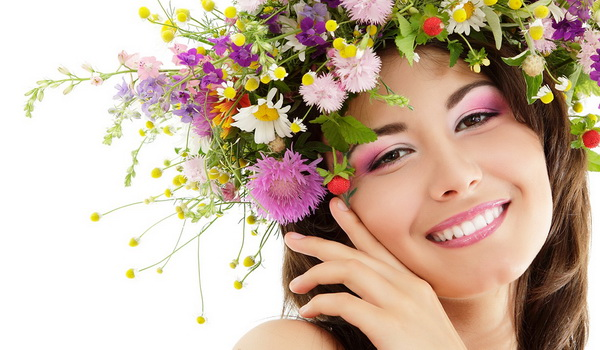 woman beauty face makeup with summer field wild flowers fresh na