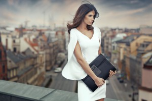 Elegant businesswoman on the roof of the building